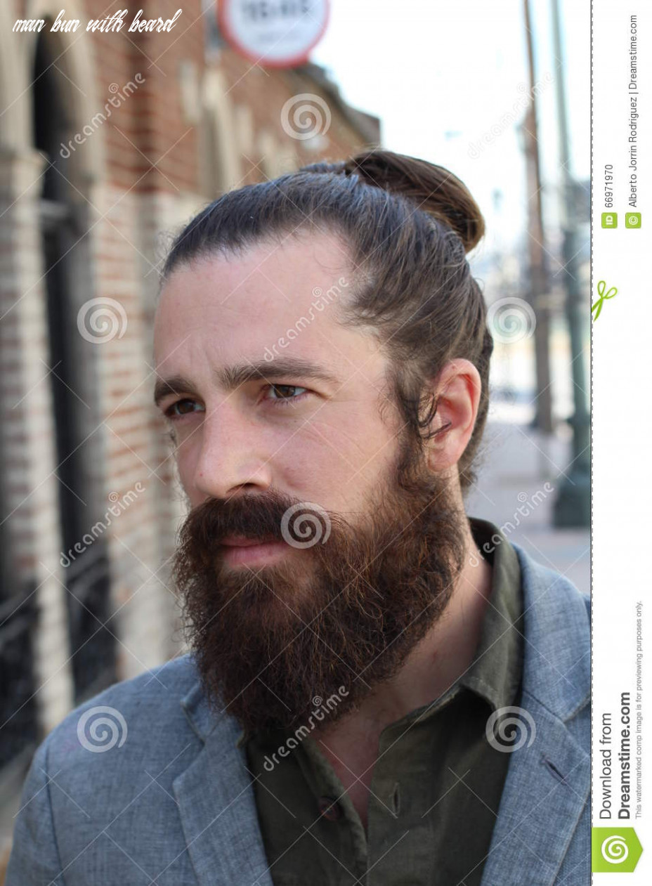 Bearded hipster model with man bun hairstyle stock photo image