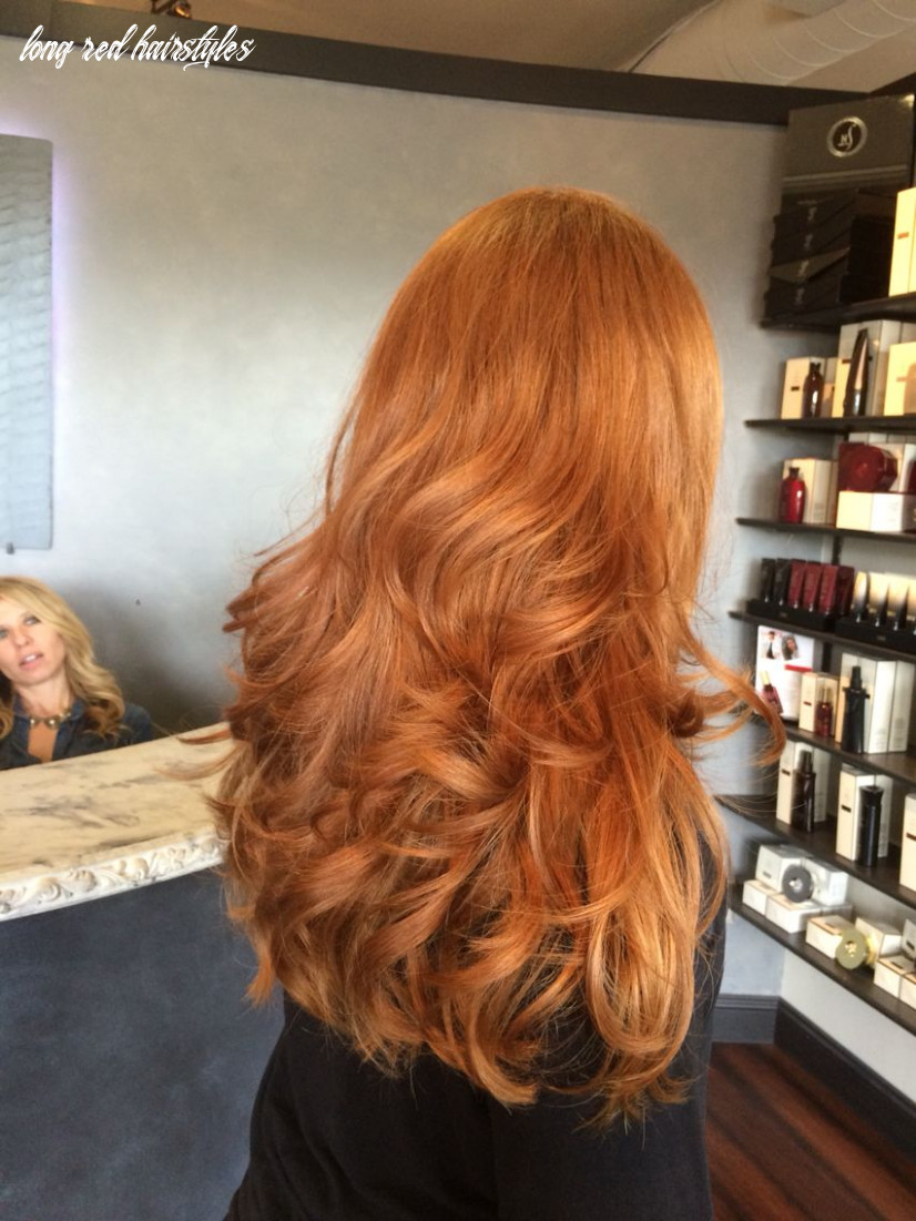 Beautiful long thick natural red head haircut by angela rose