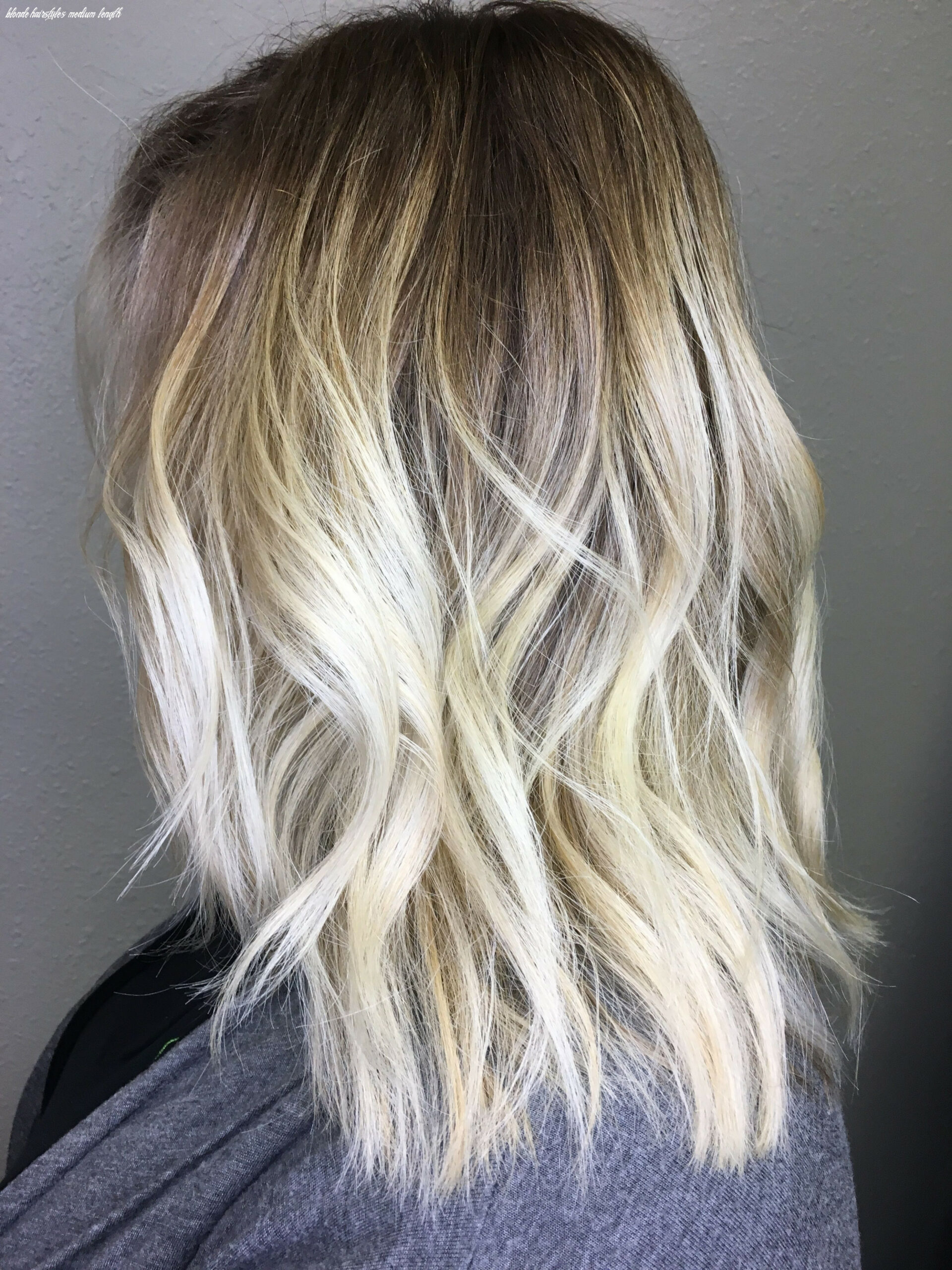 Blonde balayage! dark roots with bleach blonde ends medium length