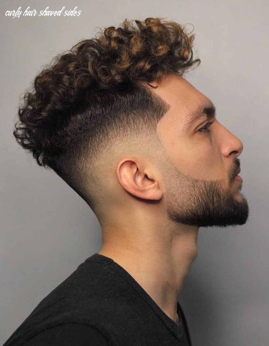 Curly hair style in man curly hair shaved sides