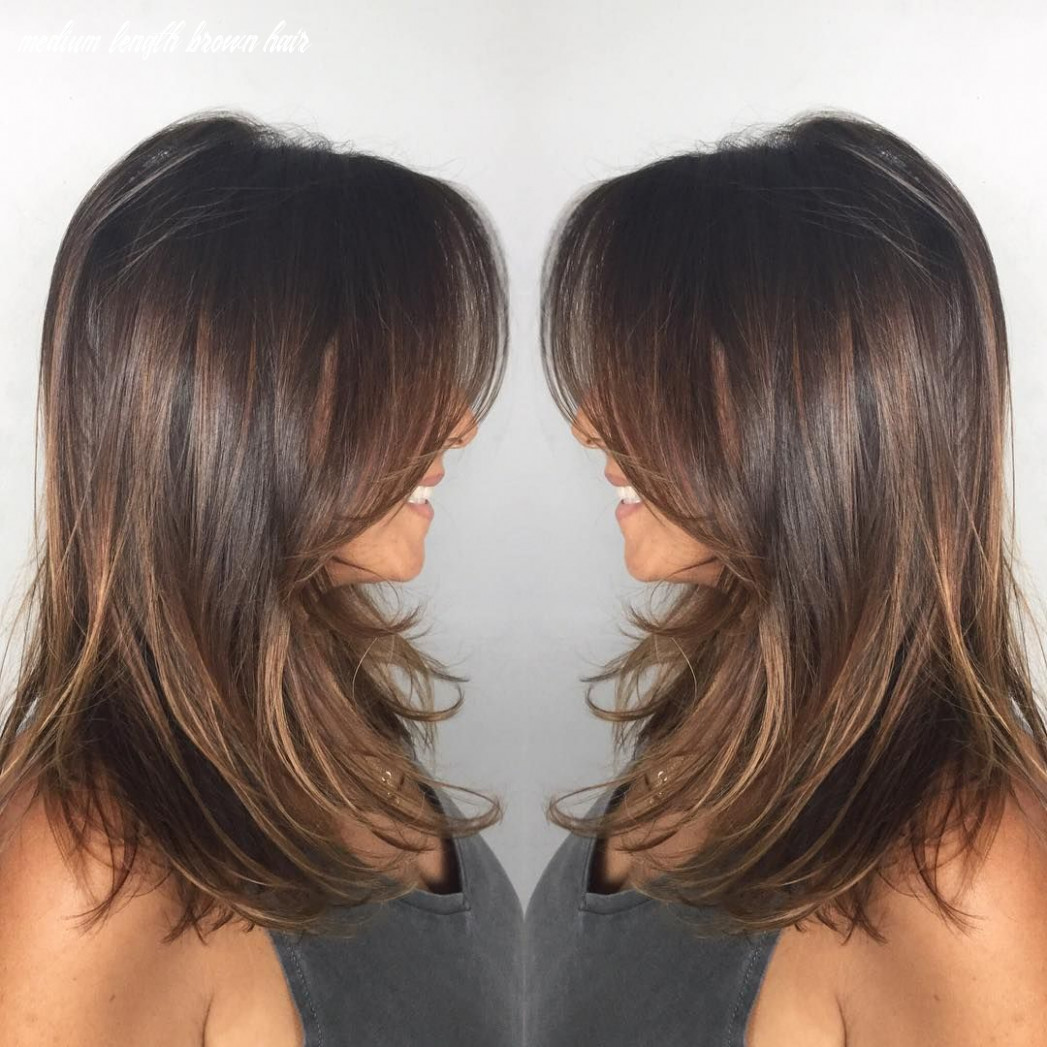 Dark ash brown mid length hair with wispy layers   haircuts for