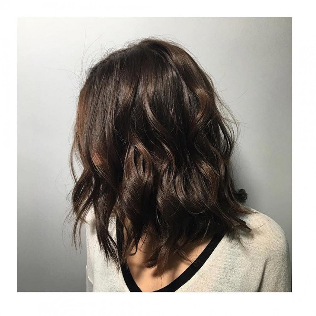Medium length chocolate brown wavy lob | brown hair colors