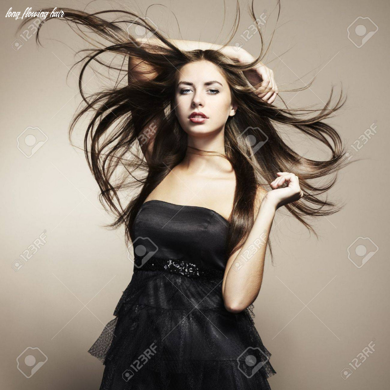Portrait of young dancing woman with long flowing hair. Fashion..