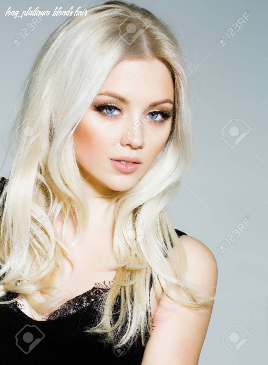 Pretty girl or cute woman with long platinum blonde hair and