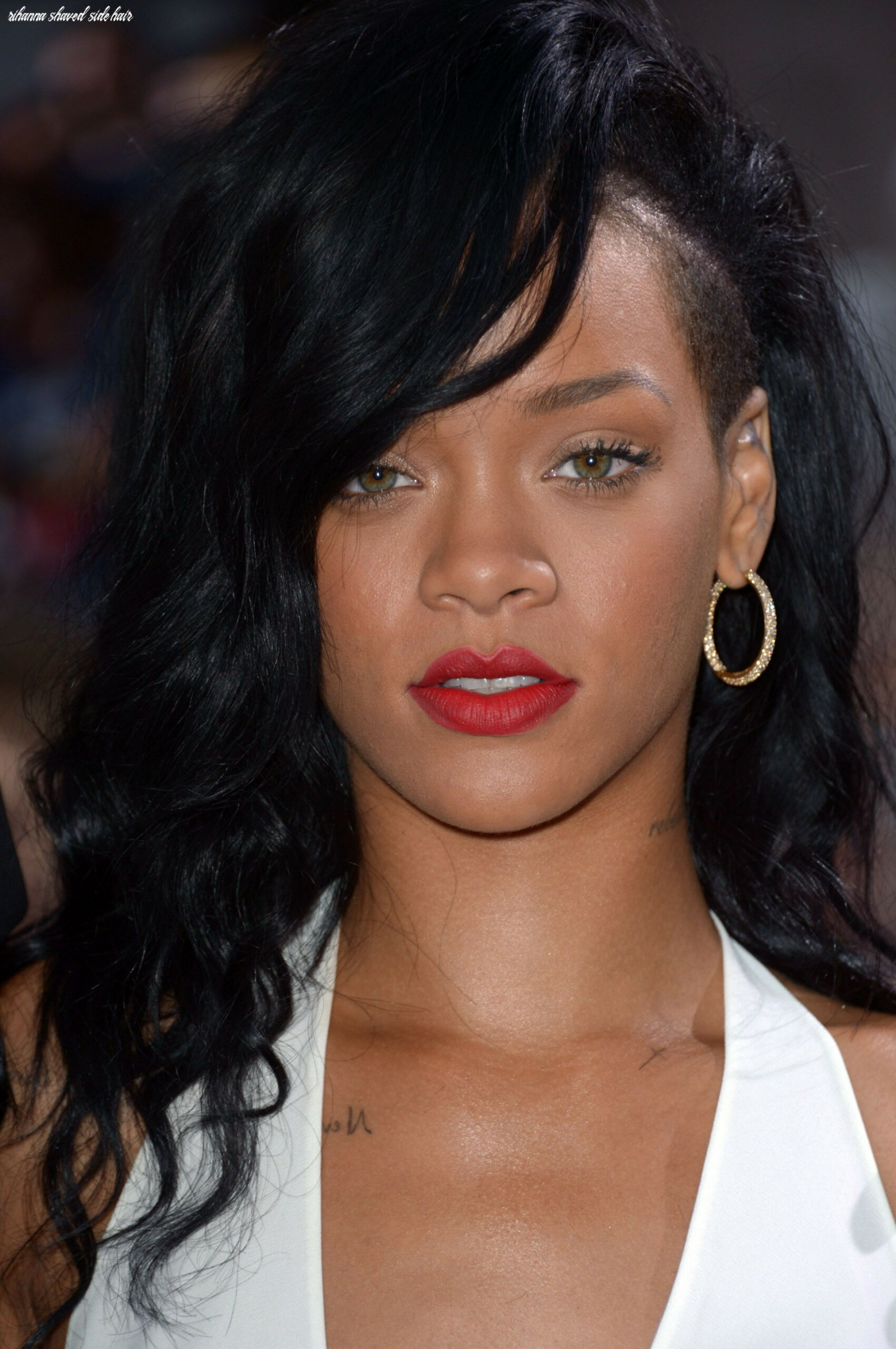 Rihanna wore bright red lips with a white dress for the premiere