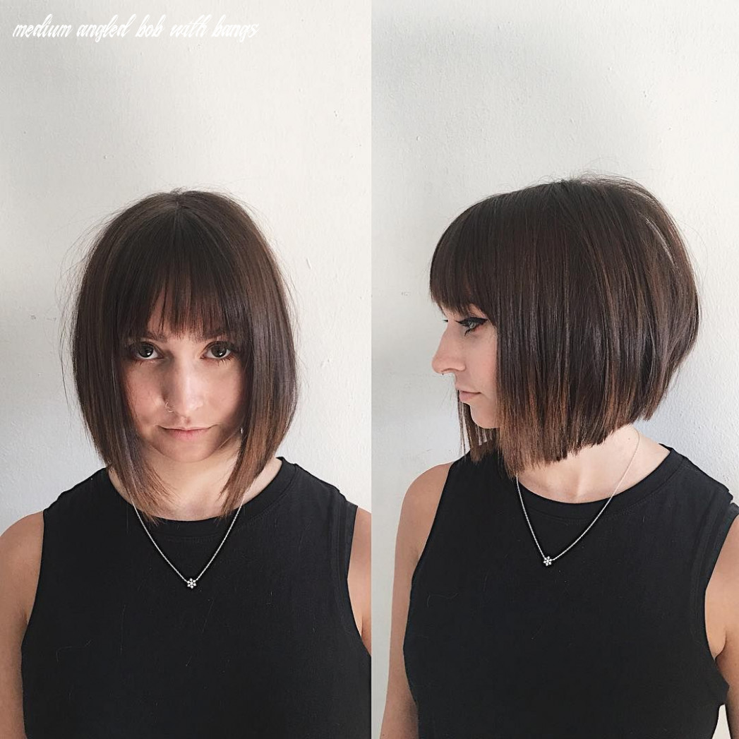 This chic blunt angled bob with feathered bangs and brunette ombre
