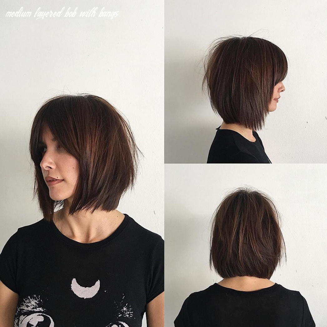 This rich brunette soft layered bob with curtain bangs and undone