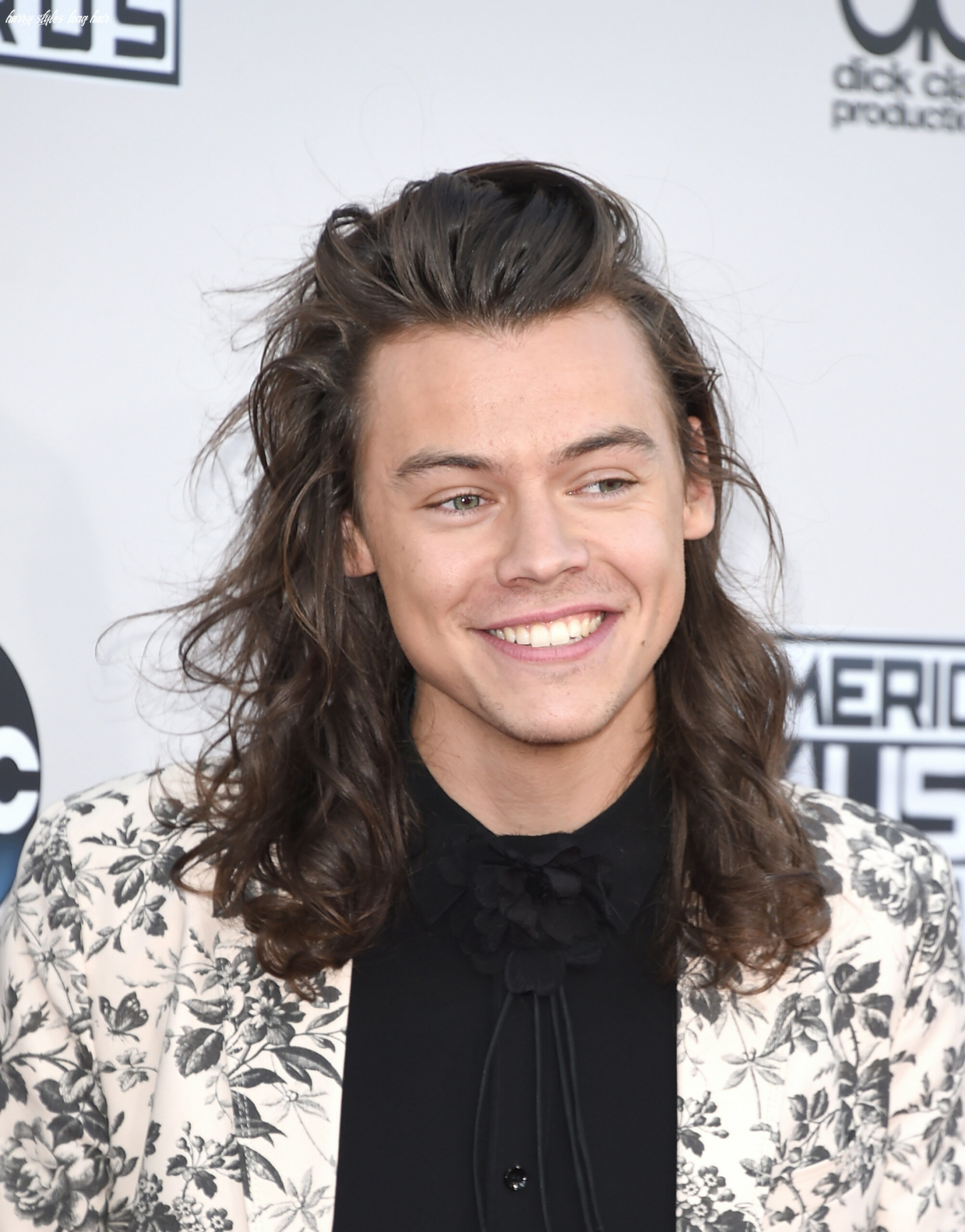 What harry styles looks like with short hair vs