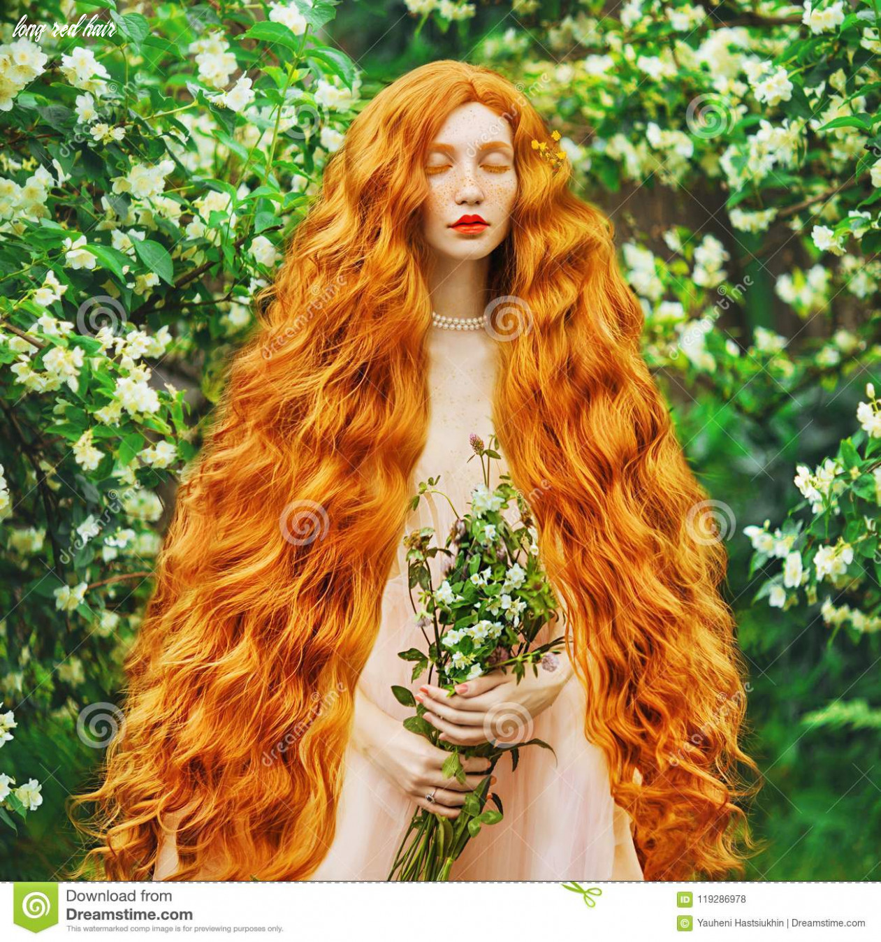 Young beautiful red haired girl with very long curly hair with
