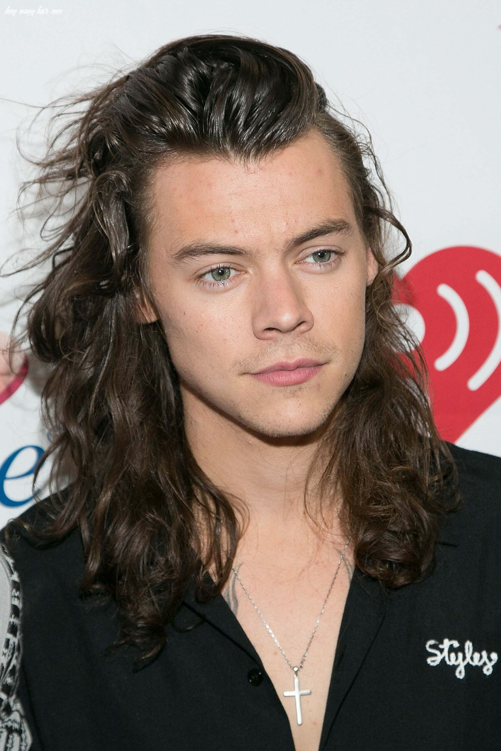 8 men with long hair: all the looks you need to know long wavy hair men