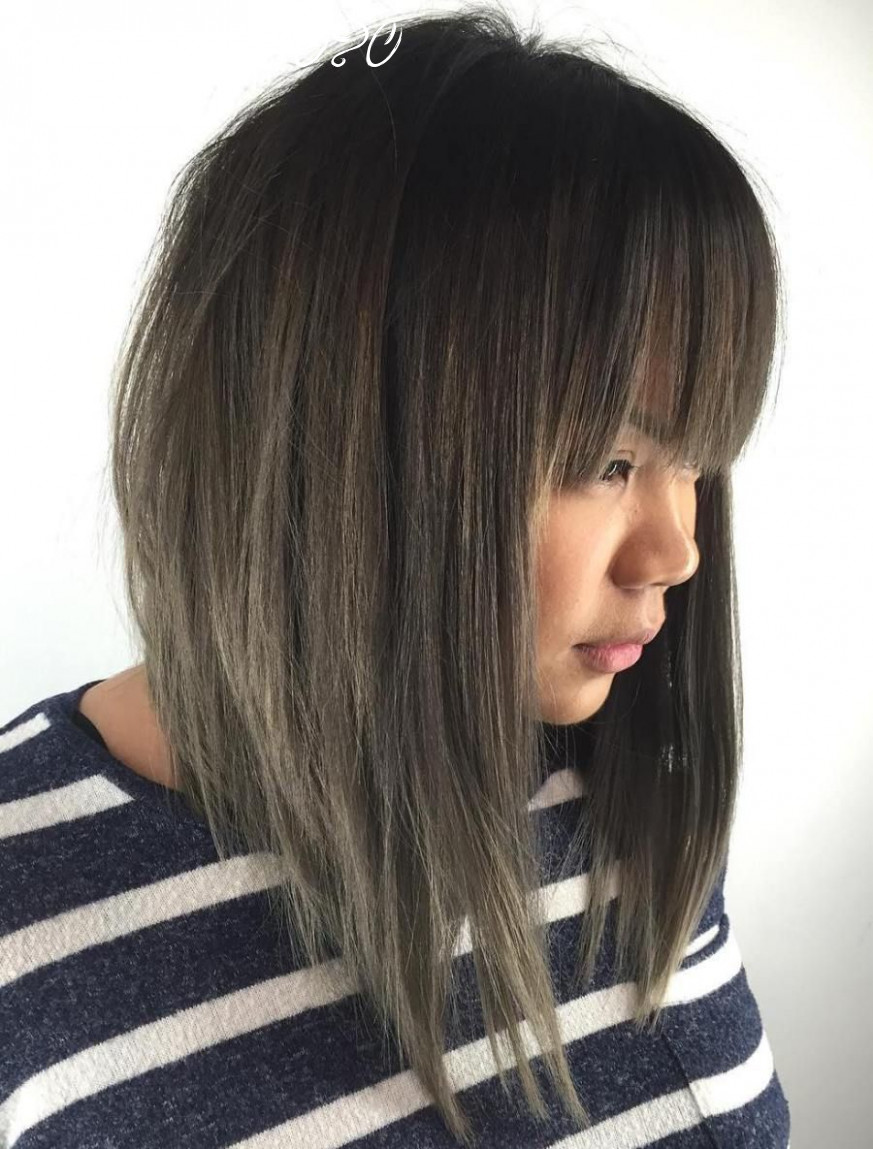 8 modern ways to style a long bob with bangs | long bob with