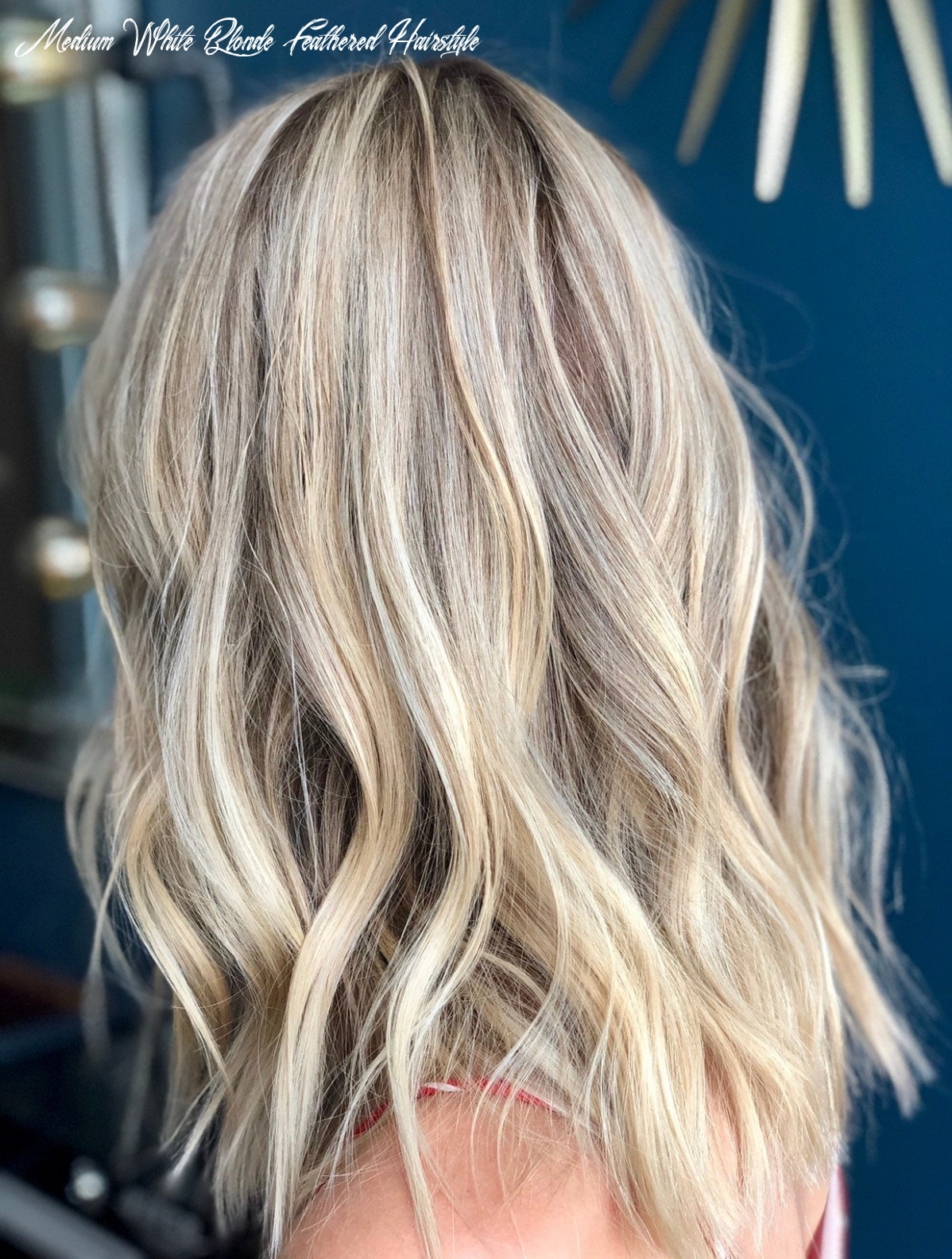 9 best blonde hair colors for 9 | glamour medium white blonde feathered hairstyle