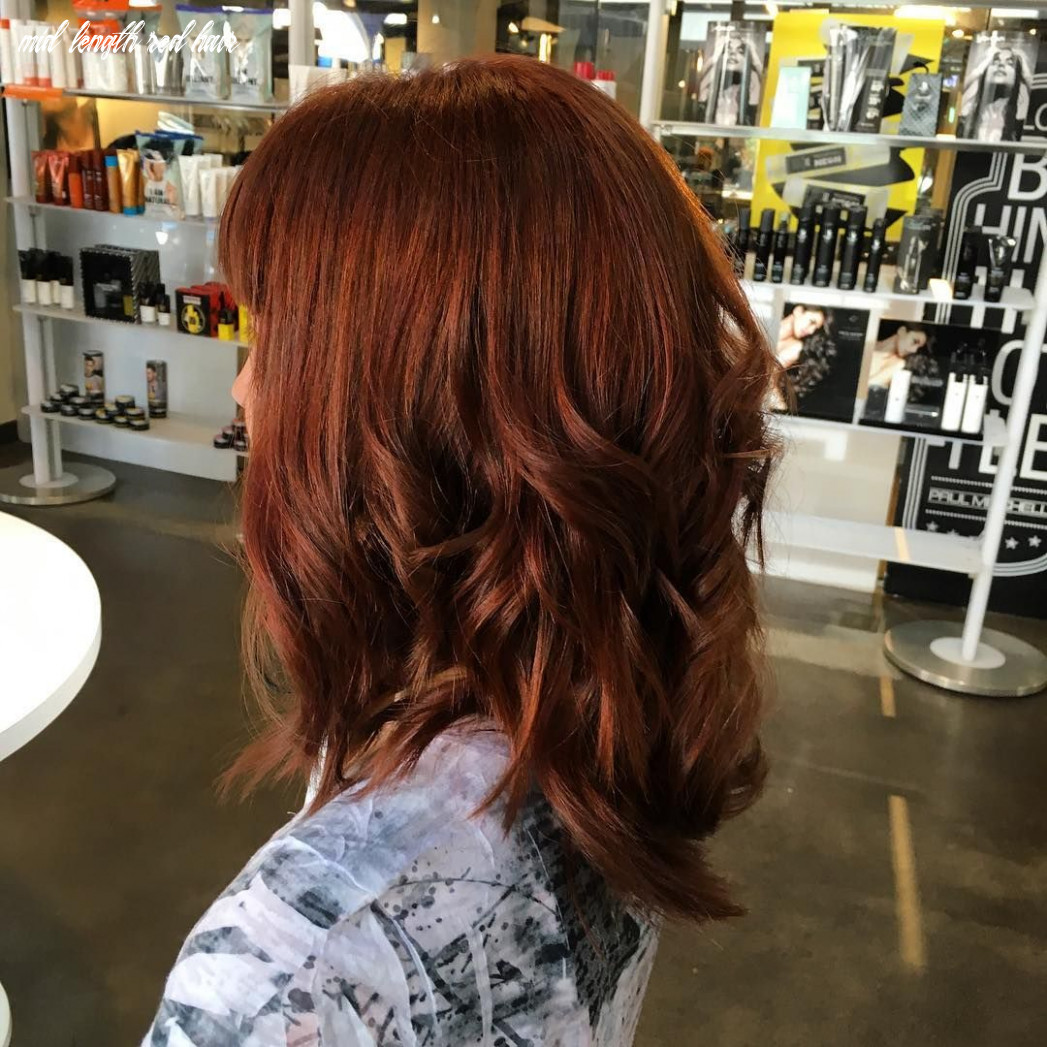 Auburn shoulder length layered hair with waves near the ends