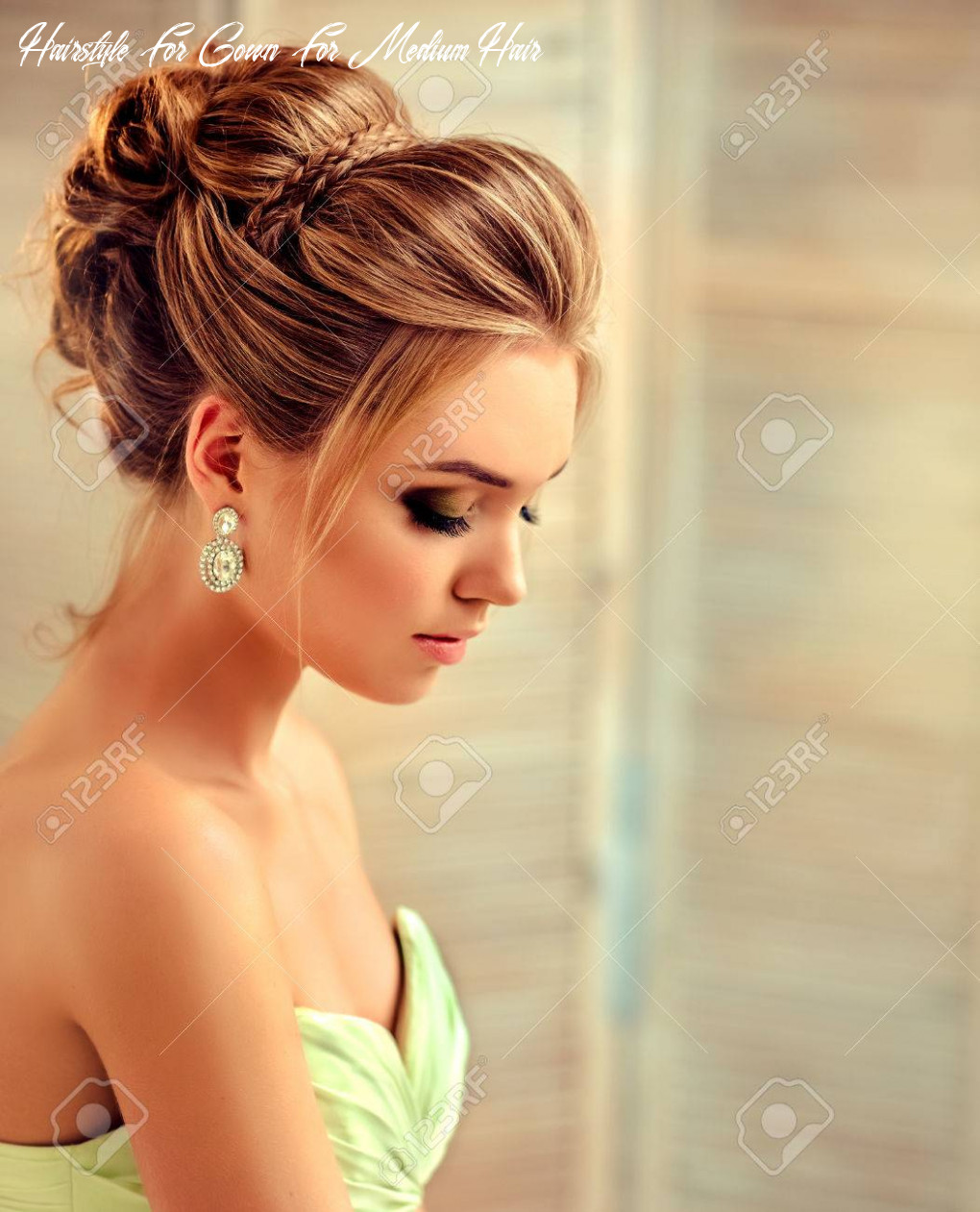Beautiful woman dressed in evening gown example of wedding hairstyle
