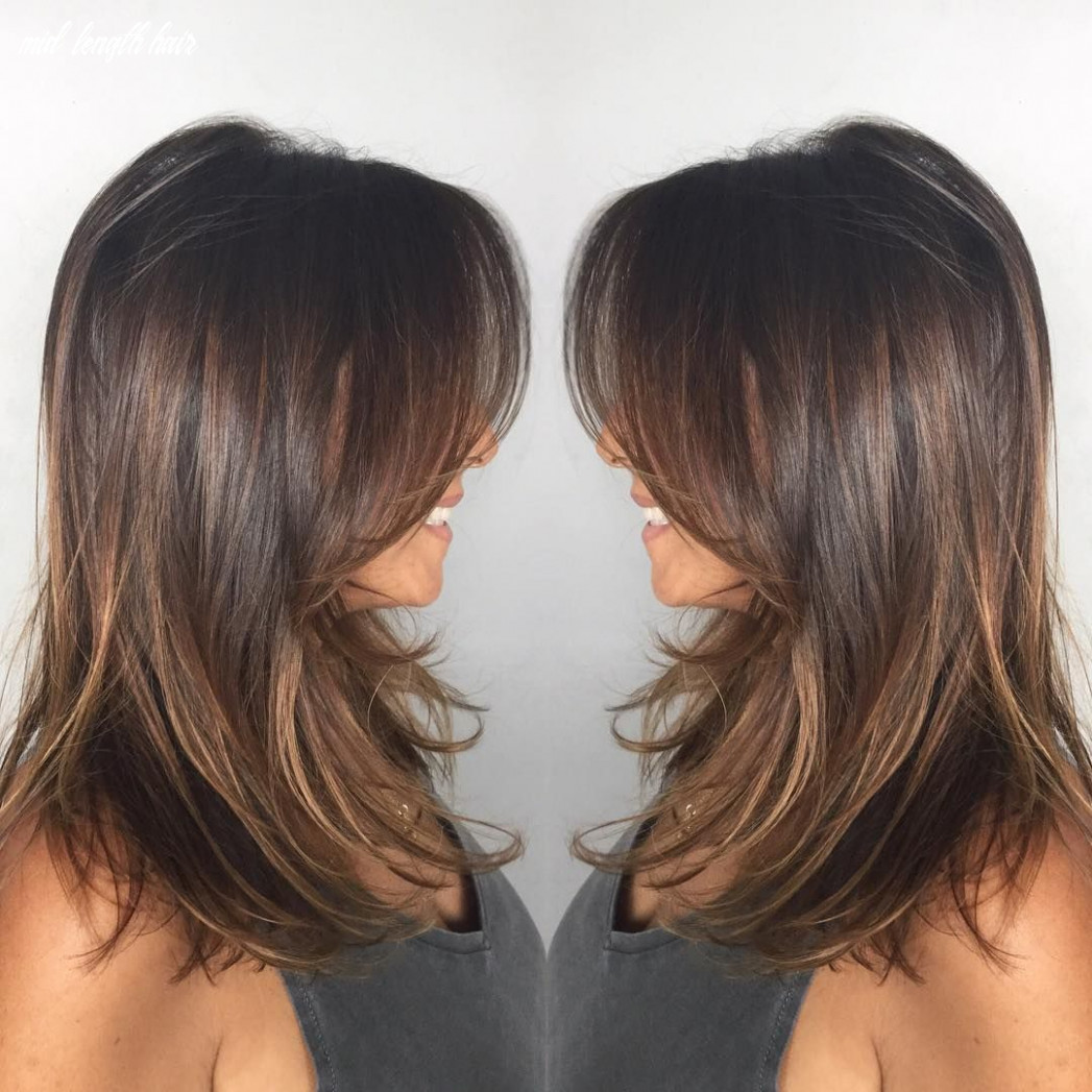 Dark ash brown mid length hair with wispy layers | haircuts for