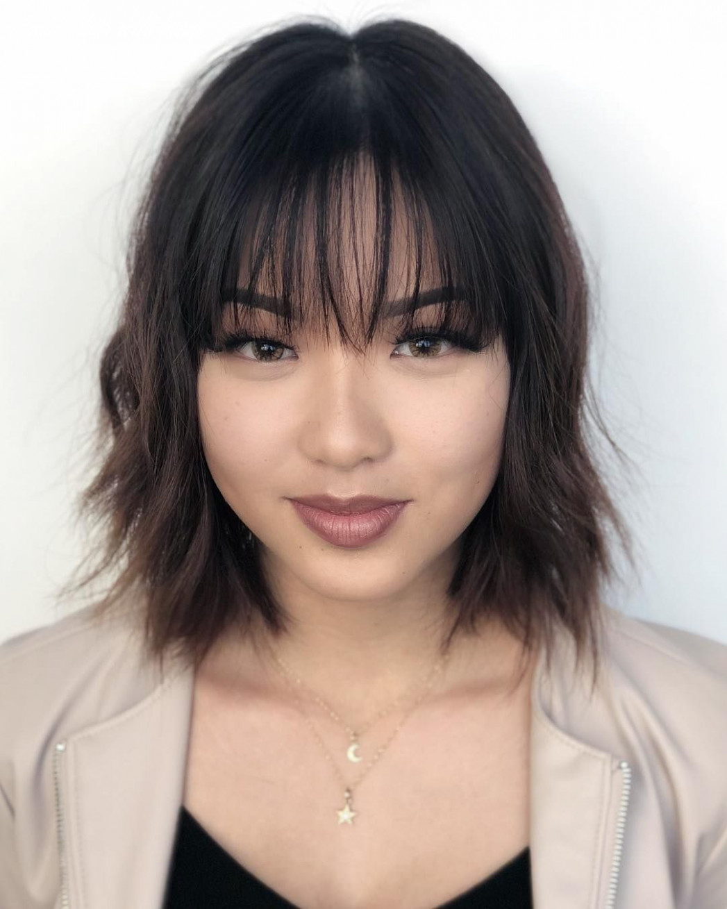 Fringe and texture are both popular hair trends right now you