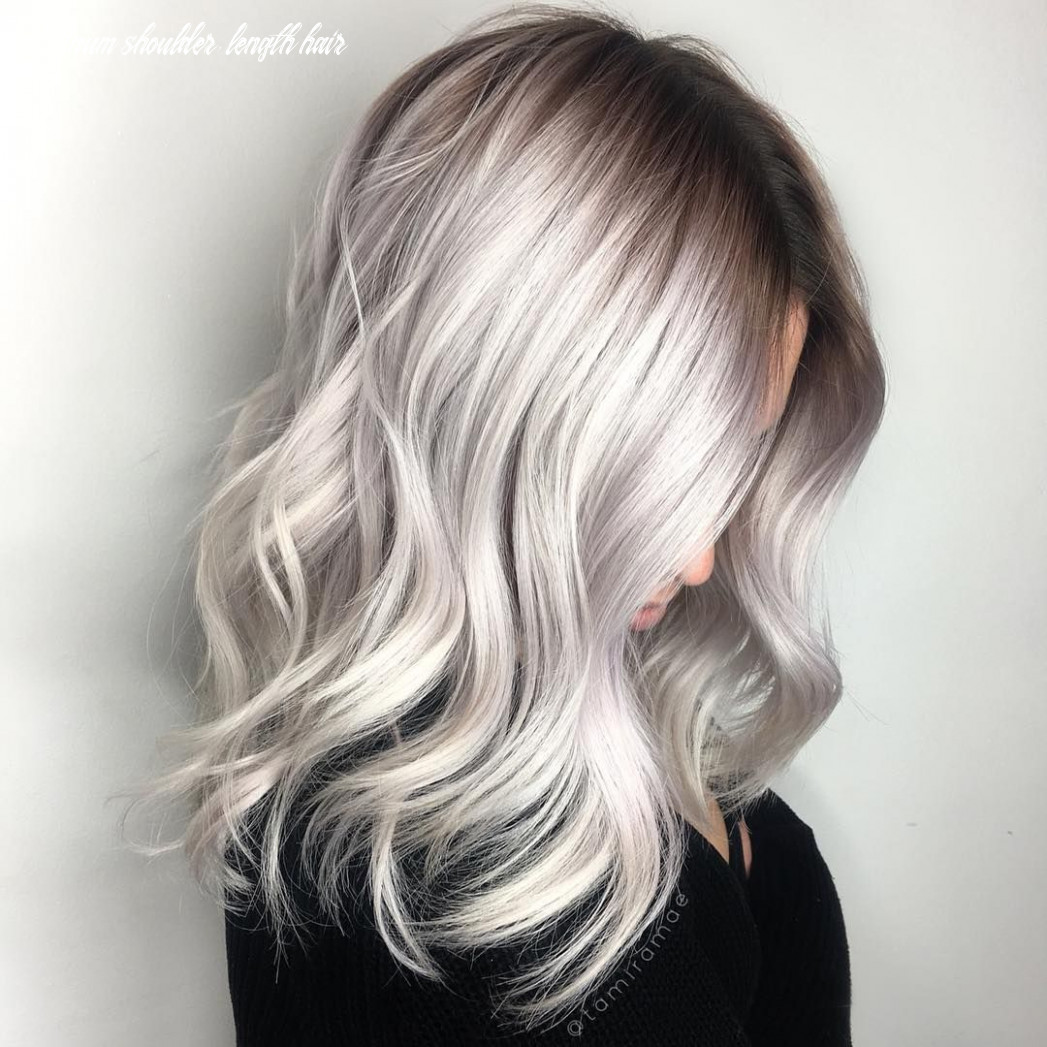 Large waves: blonde platinum silver hair with wavy curls and