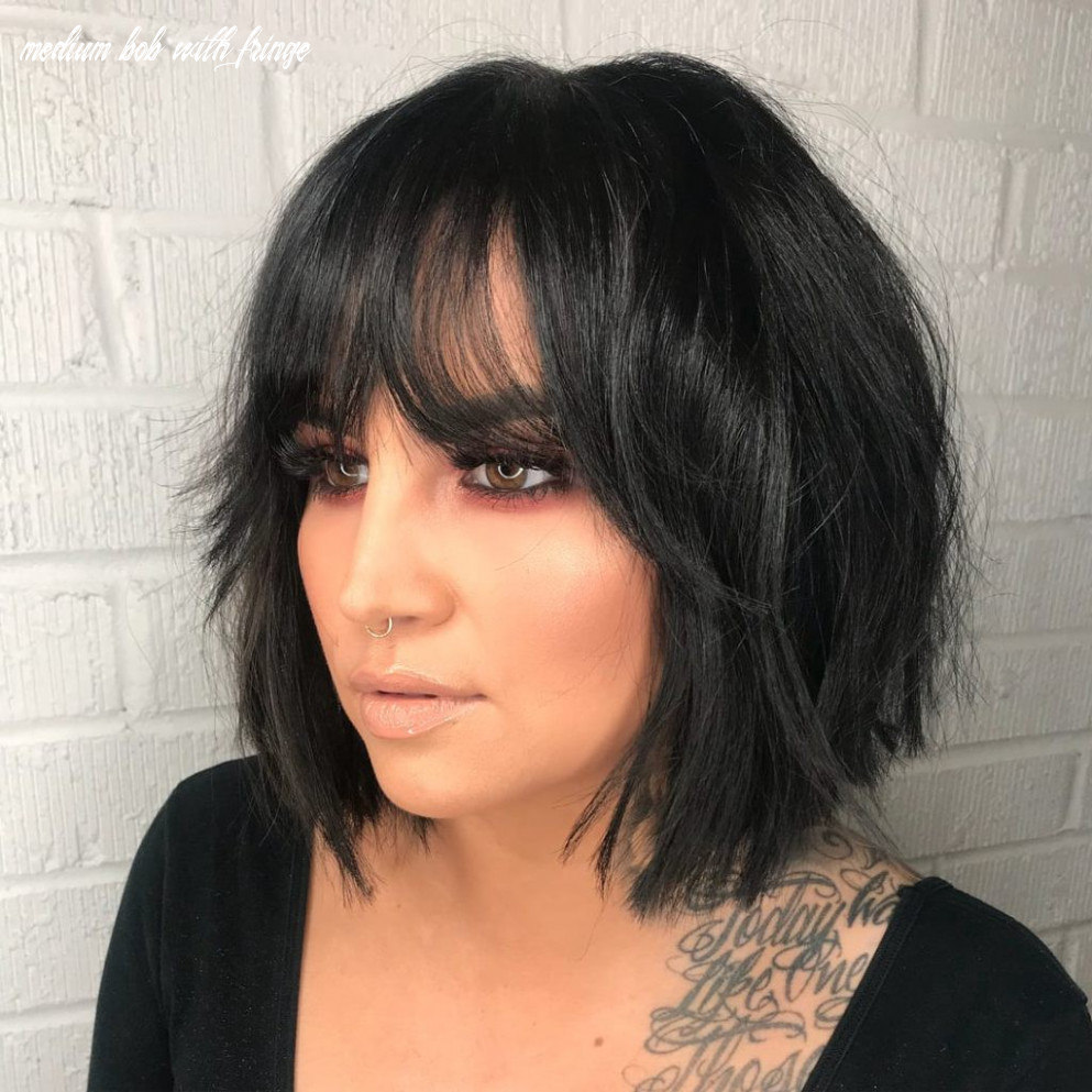 Layered modern french bob with face framing fringe bangs and messy