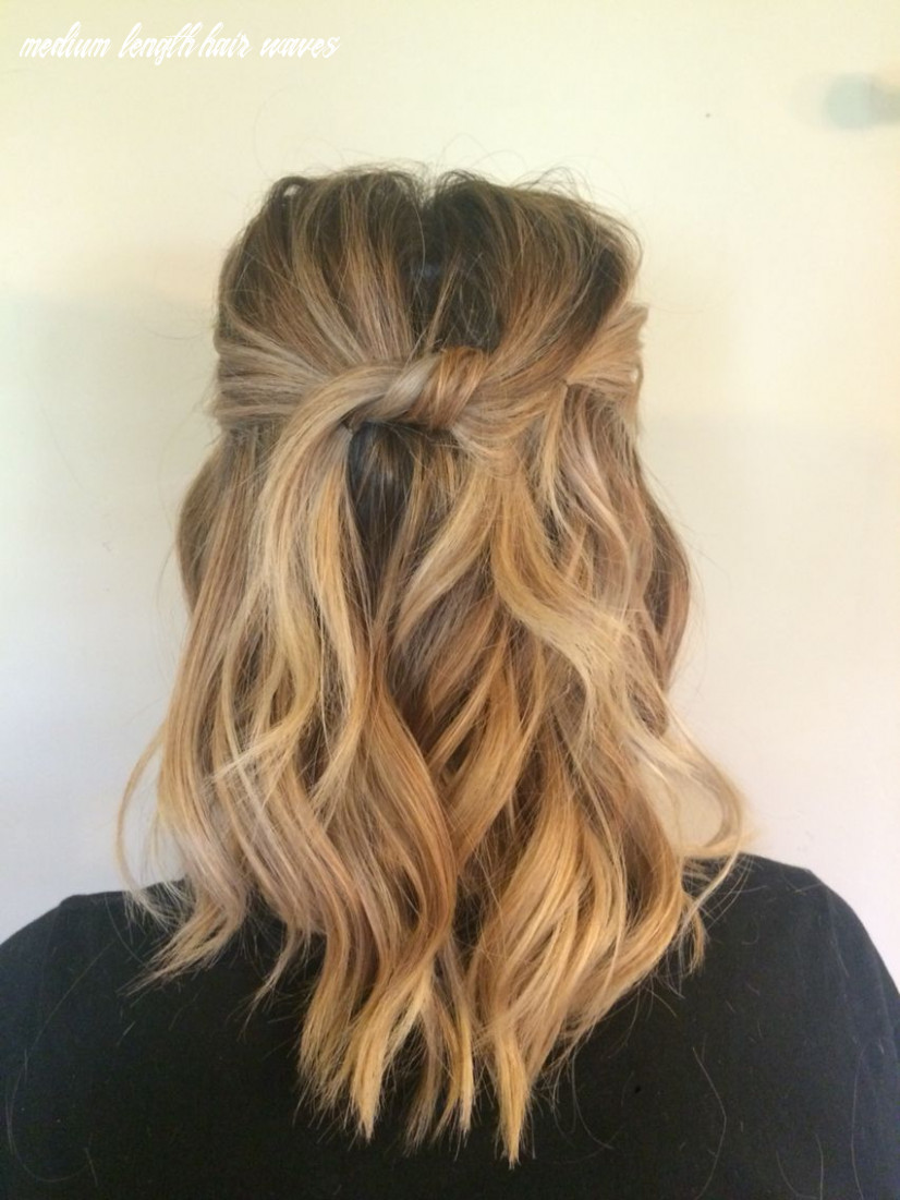 Medium length beach waves top pieces knotted and pinned