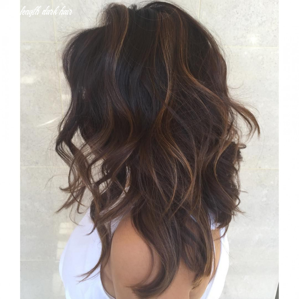Mid length wavy dark chocolate brown hair with lots of layers