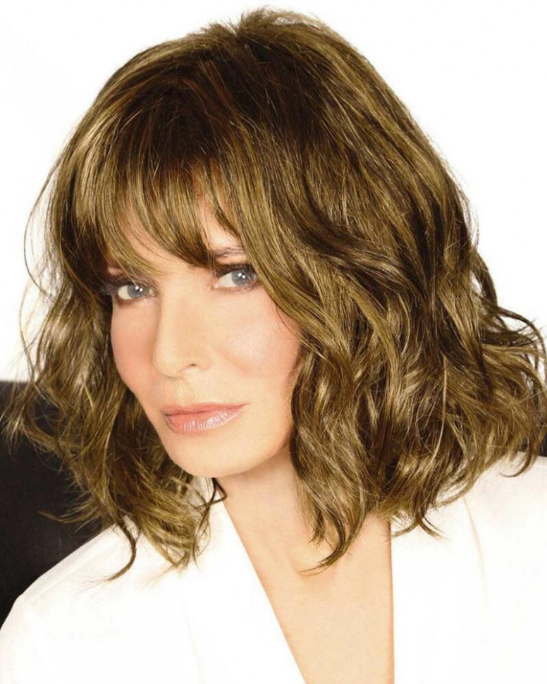 On trend mid length wig with beachy waves and a sexy laid back vibe shoulder length waves
