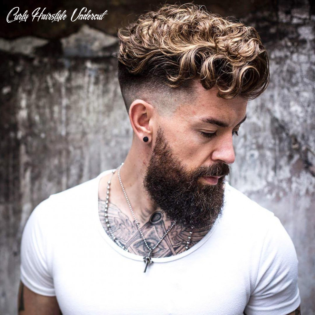 Picture of a curly hairstyle for a hipster man curly hairstyle undercut