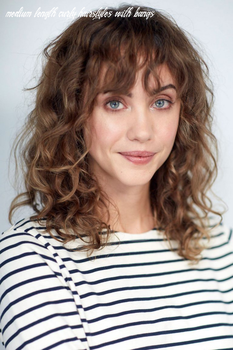 Pin on faces medium length curly hairstyles with bangs