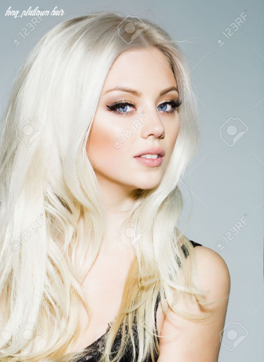 Pretty girl or cute sexy woman with long platinum blonde hair