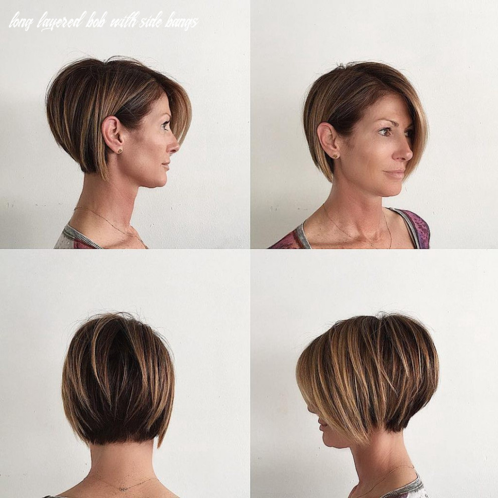 Stacked layered bob with long side swept bangs and brunette color