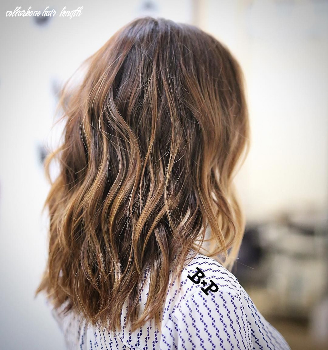 Wavy chestnut brown collarbone length hair with caramel balayage